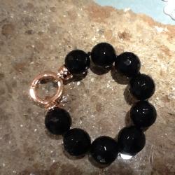 bracciale gioiello artigianale cristallo nero sfaccettato chiusura acciaio ramato rame pietra oro argento bracciali gioielli artigianali artigiana orafa pietre quarzi sfaccettati chiusure ramati